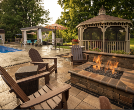 Property Pros backyard complete with a firepit, pool, pergola and gazebo.