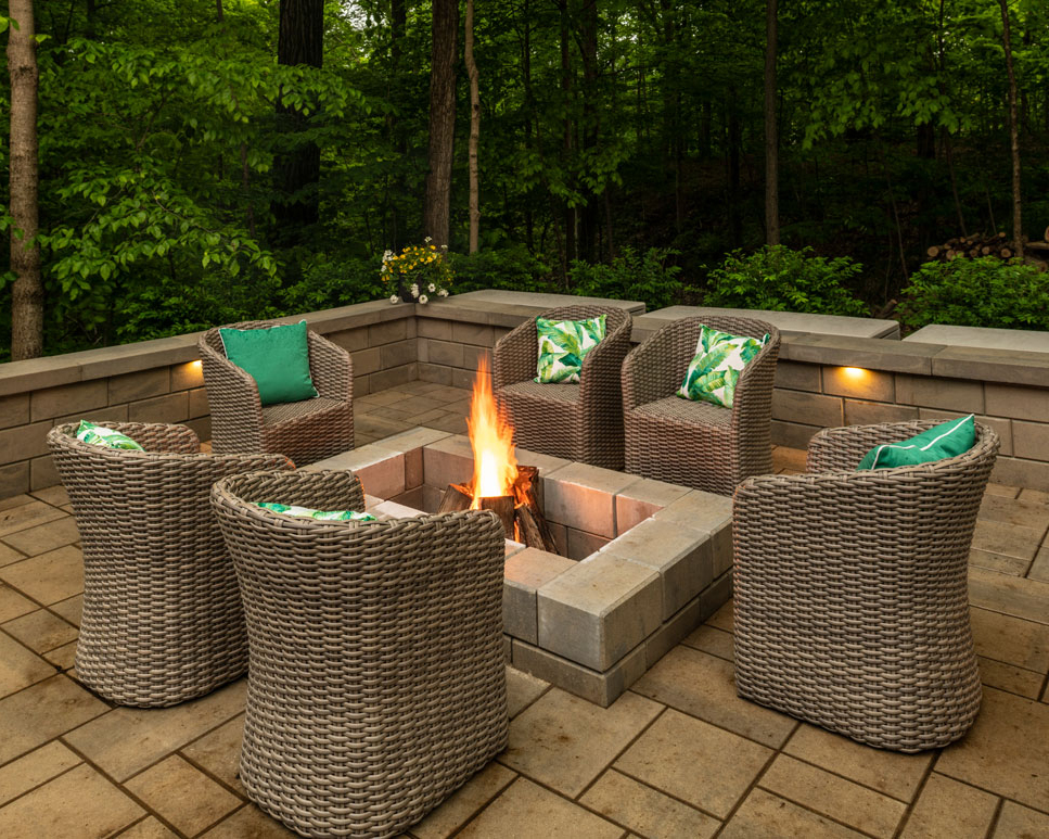 wood burning fire feature with paver retaining walls