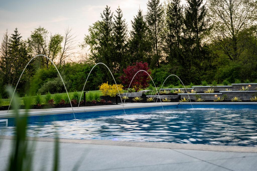 modern landscape design surrounds pool